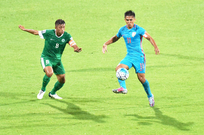 India's Sunil Chettri and Macau's Cheang Cheng vie for the ball during their AFC Asian Cup qualifier at Kanteerava Stadium in Bengaluru on Wednesday
