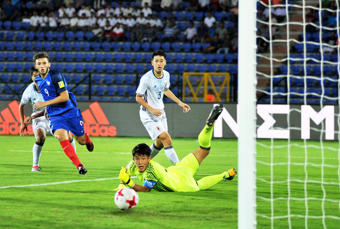 France's Amine Gouiri shoots past Japan 'keeper as the other players watch in disbelief during their FIFA U-17 World Cup match in Guwahati on Wednesday
