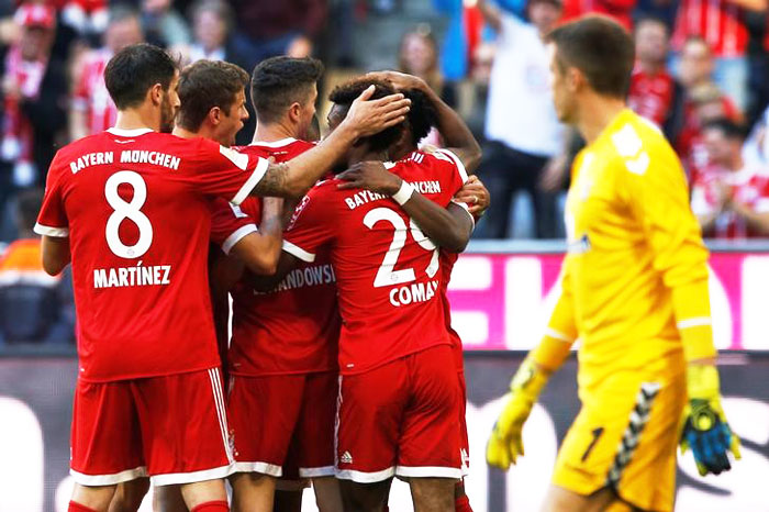 Bayern Munich players celebrate after Thomas Mueller scores against Freiburg on Saturday