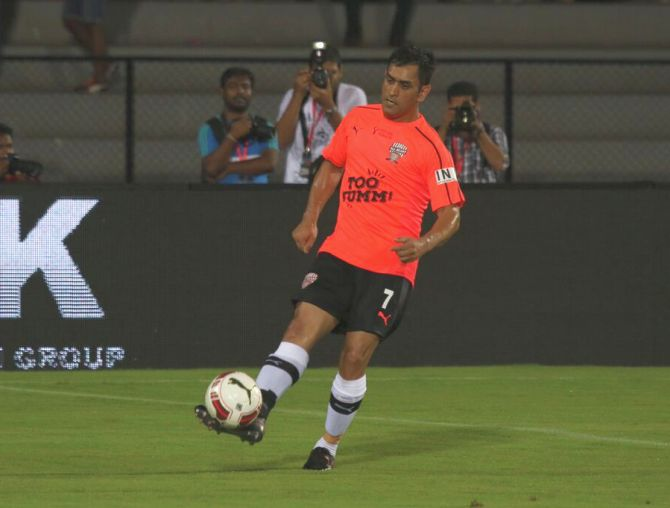 Images: Dhoni bends it like Beckham as All Hearts down All Stars