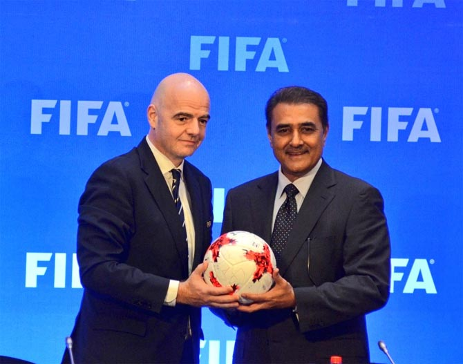 AIFF president Praful Patel, right, with FIFA president Gianni Infantino