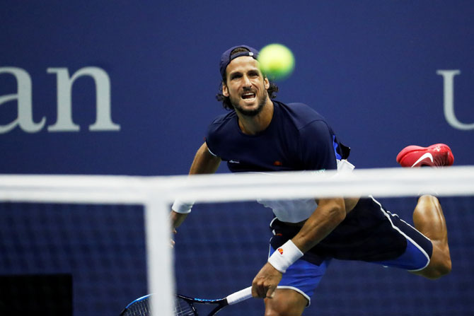 Feliciano Lopez in action during his third round match against Roger Federer