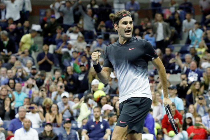 Switzerland's Roger Federer reacts upon winning match point of his third round match against Spain's Feliciano Lopez on day six of the US Open tennis tournament in Ashe Stadium at the USTA Billie Jean King National Tennis Center on Saturday