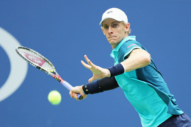 South Africa's Kevin Anderson plays a return against Spain's Pablo Carreno Busta
