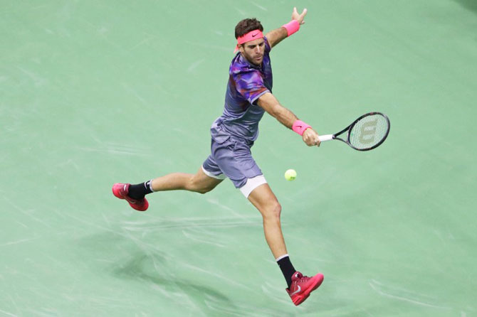 Juan Martin del Potro reaches for a backhand against Rafael Nadal
