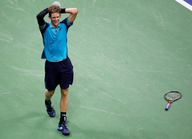 South Africa's Kevin Anderson celebrates his win against Spain's Pablo Carreno Busta