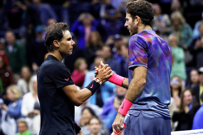 Rafael Nadal is congratulated by Juan Martin del Potro after their match in the US Open semi-final on Friday