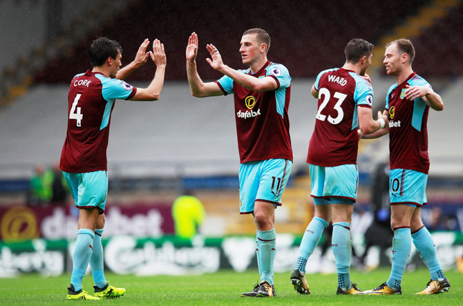 Burnley's Chris Wood celebrates with Jack Cork after the match against Crystal Palace in Burnley on Sunday