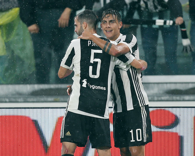 Paulo Dybala of Juventus FC celebrates after scoring a goal during their Serie A match against AC Chievo Verona in Turin, Italy, on Saturday
