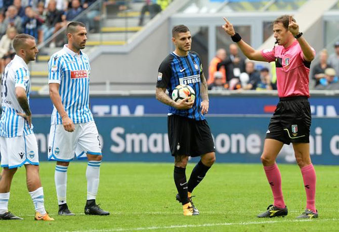 Referee Claudio Gavillucci awards a penalty to Inter Milan after a video review as Mauro Icardi prepares to take the kick during the Serie A match between Inter and SPAL in Milan on Sunday