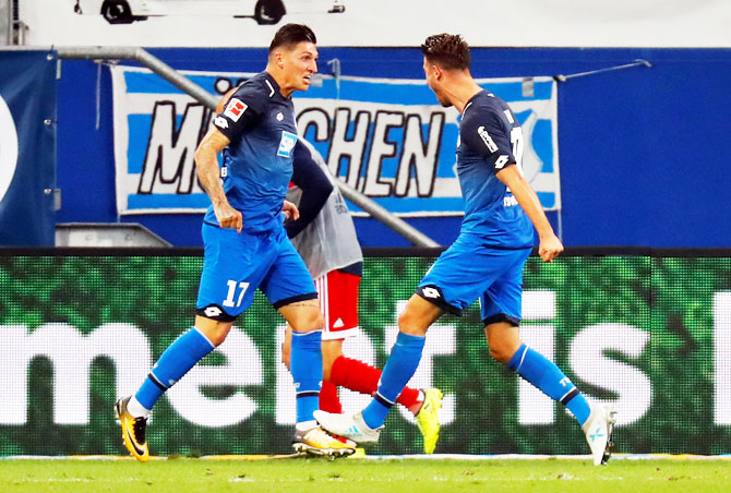 Hoffenheim's Mark Uth celebrates scoring their second goal with Steven Zuber during their Bundesliga match on Saturday