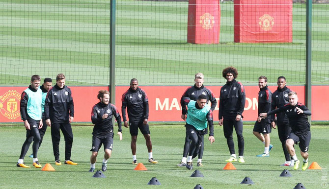 Manchester United players perform drills at a training session at Carrington on Monday