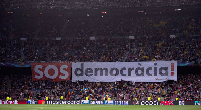Fans display a banner during the UEFA Champions League Group D match between FC Barcelona and Juventus on Tuesday