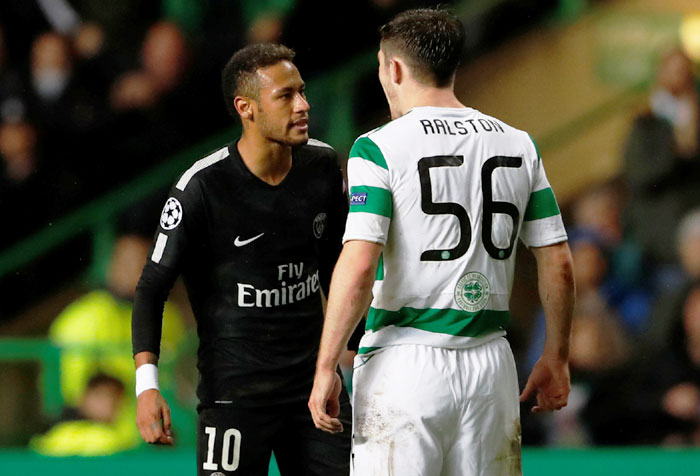 Paris Saint-Germain's Neymar clashes with Celtic's Anthony Ralston during their match at Celtic Park on Tuesday