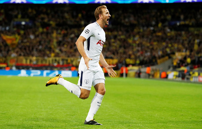 Tottenham's Harry Kane celebrates scoring their third goal against Borussia Dortmund in their home game at Wembley Stadium