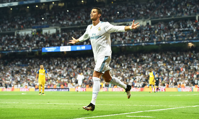 Real Madrid's Cristiano Ronaldo celebrates scoring the first goal against APOEL Nikosia during their UEFA Champions League group H match at Estadio Santiago Bernabeu in Madrid on Wednesday