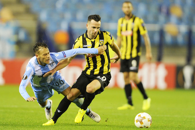SS Lazio's Alessandro Murgia competes for the ball with Vitesse's Thomas Bruns during their UEFA Europa League Group K match at Gelredome in Arnhem, Netherlands, on Thursday
