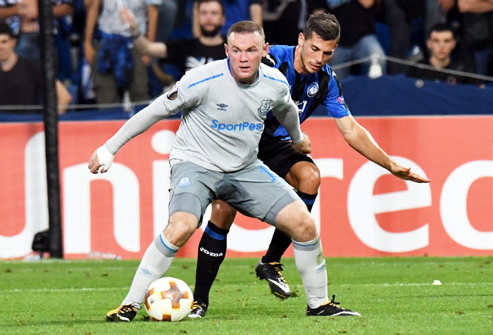 Everton FC's Wayne Rooney and Atalanta's Remo Freuler vie for possession during their UEFA Europa League Group E match at Stadio Citta del Tricolore in Reggio nell'Emilia, Italy, on Thursday