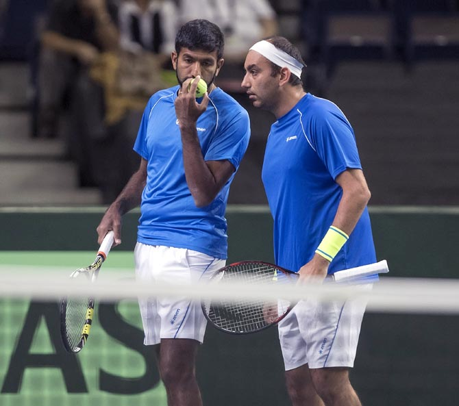 Rediff Sports - Cricket, Indian hockey, Tennis, Football, Chess, Golf - Davis Cup: Bopanna-Raja lose as India's hopes suffer