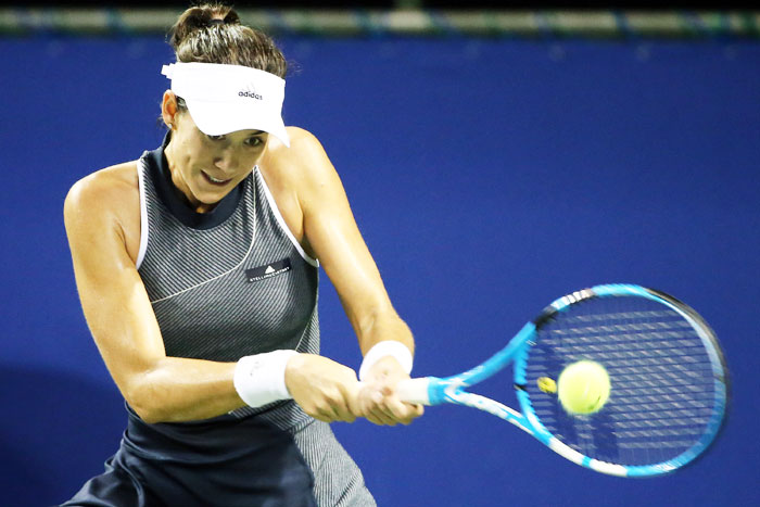 Spain's Garbine Muguruza plays a backhand in her quarter-final match against France's Caroline Garcia during day five of the Toray Pan Pacific Open Tennis At Ariake Coliseum in Tokyo, on Friday