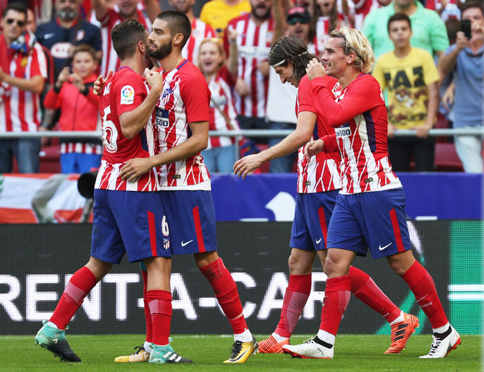 Atletico Madrid's Antoine Griezmann celebrates with teammates after scoring their second goal against Sevilla at Wanda Metropolitano, Madrid on Saturday