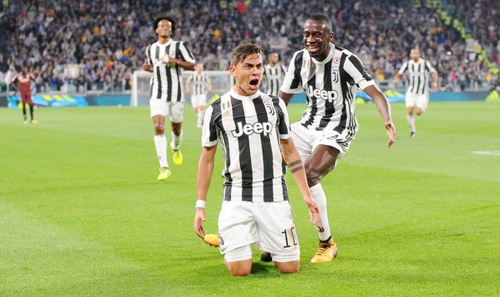 Juventus' Paulo Dybala celebrates scoring their first goal with Blaise Matuidi during their Serie A match on Saturday