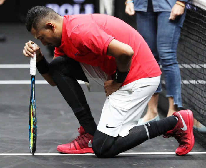 Rediff Sports - Cricket, Indian hockey, Tennis, Football, Chess, Golf - Did controversial Kyrgios kneel in protest against Trump?