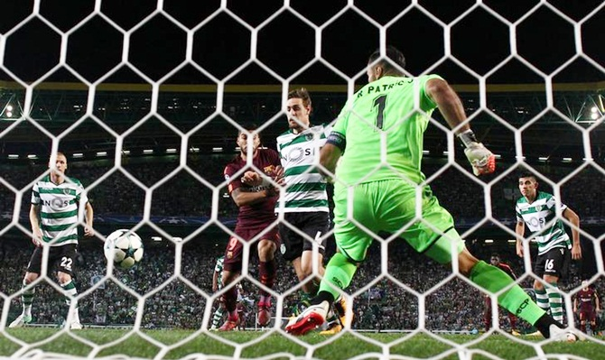 Sporting CP's Sebastian Coates deflects the ball into his own goal against Barcelona