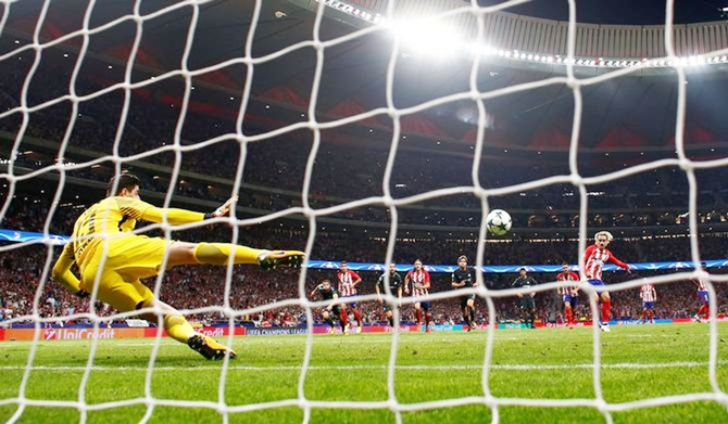 Antoine Griezmann puts Atletico Madrid ahead from the penalty spot against Chelsea