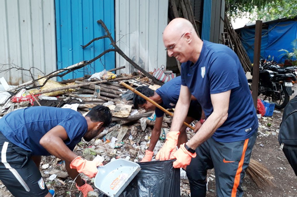 Indian football coach Stephen Constantine and members of the Indian football team get down to work as they participate in the 'Swachhta Hi Seva campaign