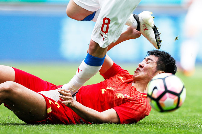 China's Liu Yiming and the Czech Republic's Vladimir Darida in action during the China Cup on March 26