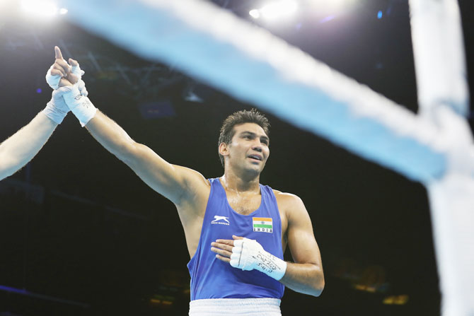India's Manoj Kumar celebrates after his victory against Nigeria's Osita Umeh on Day 1 of the Gold Coast 2018 Commonwealth Games at Oxenford Studios on the Gold Coast, on Thursday
