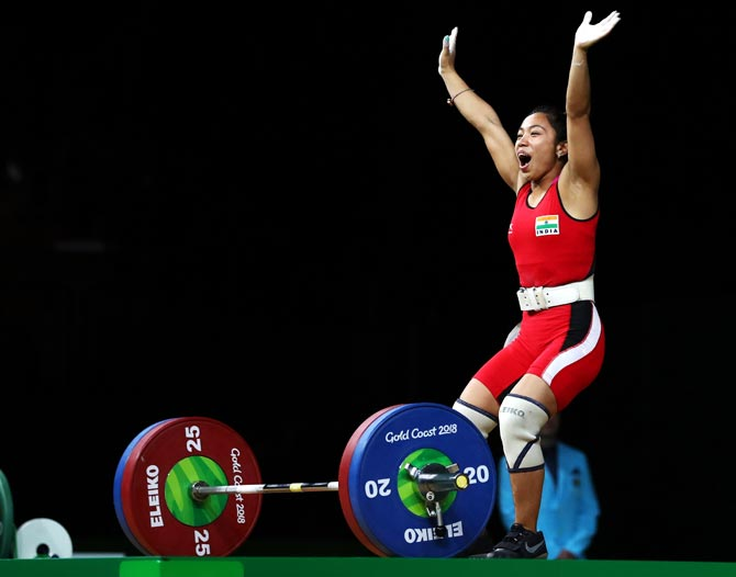Mirabai Chanu celebrates after winning gold in the women's weightlifting 48kg category