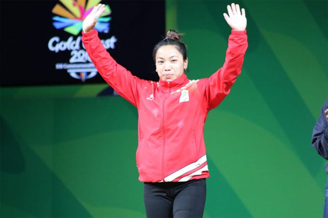 Mirabai Chanu steps up on the podium to receive her gold medal