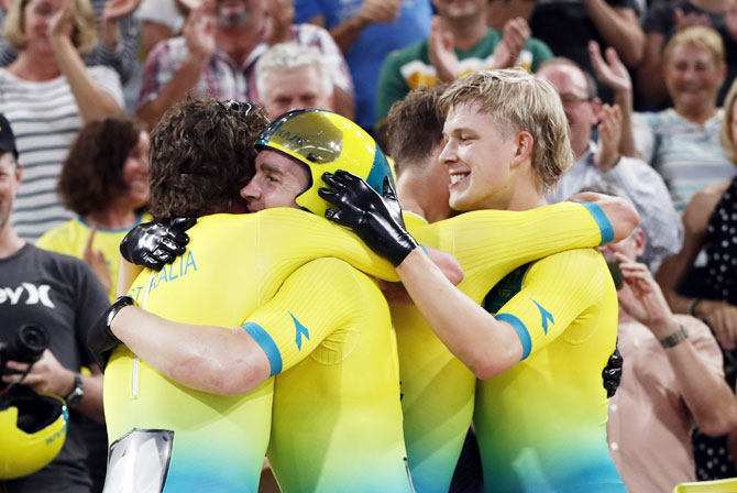 Alex Porter, Sam Welsford, Leigh Howard and Kelland O'Brien of Australia celebrate after winning the gold medal in the Men's 4000m Team Pursuit track cycling final at the Anna Meares Velodrome on Thursday