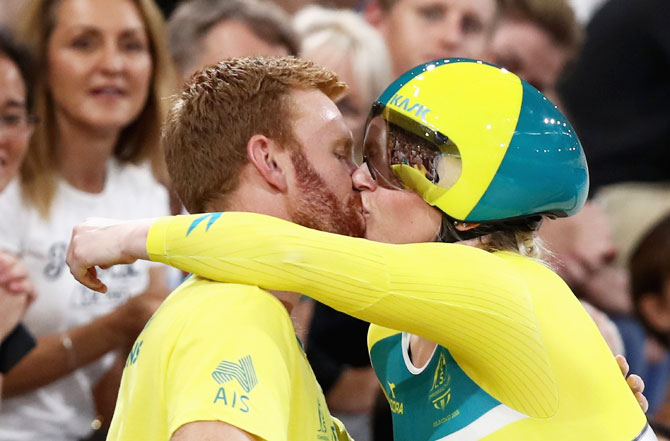 Australia's Stephanie Morton is congratulated by her partner after winning the Women's Sprint Gold gold at Anna Meares Velodrome in Brisbane