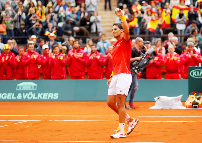 Spain's Rafael Nadal celebrates winning his Davis Cup quarter-final match against Germany's Philipp Kohlschreiber at Plaza de Toros de Valencia, in Valencia on Friday