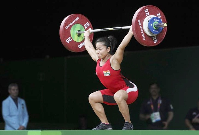 PM Modi hails weightlifters Sanjita Chanu, Lather