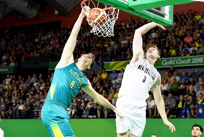 Australia's Brad Newley slam dunks during the preliminary basketball round match against New Zealand at Cairns Convention Centre in Cairns