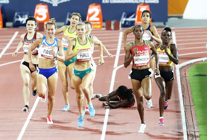 Kenya's Winny Chebet falls in the Women's 1500 metres heats at Carrara Stadium on Monday