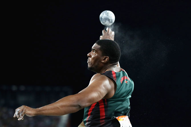 Dominica's Dillon Simon competes in the men's shot put final at Carrara Stadium on Monday
