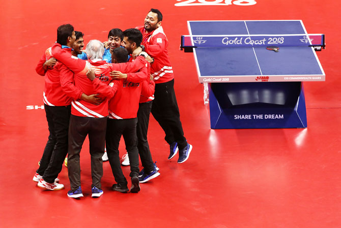 India's Table Tennis team celebrate after defeating Nigeria to win the gold medal at Oxenford Studios on Monday
