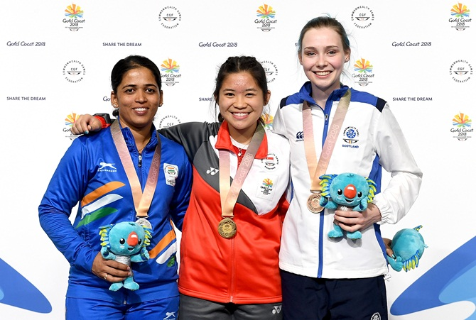 Singapore's Martina Lindsay, India's  Tejaswini Sawant and Seonaid McIntosh of Scotland pose with their medals after the women's 50m Rifle Prone shooting event at the Commonwealth Games on Thursday