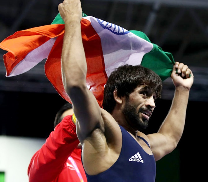 Bajrang leads Indian wrestlers' charge; silver for Khatri, Dhanda