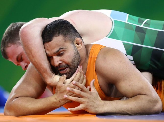 India's Mausam Khatri competes against Martin Erasmus of South Africa in the men's freestyle 97 kg