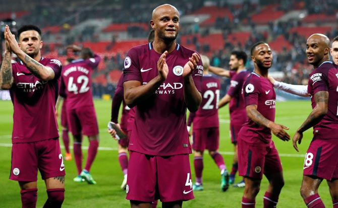 Manchester City's Vincent Kompany and his team-mates applaud the fans after the match against Tottenham Hotspur on Saturday