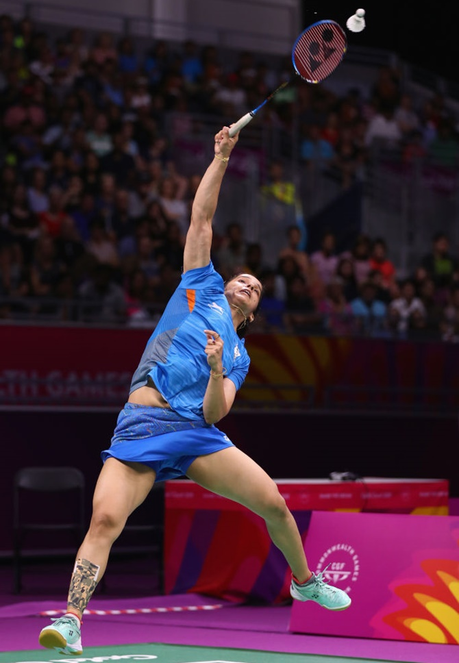 Aggressive Saina clinches women's singles gold in CWG ... | 670 x 968 jpeg 145kB
