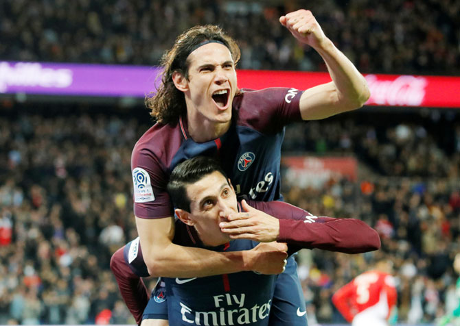 PSG's Edinson Cavani and Angel di Maria celebrate the third goal against AS Monaco in their 7-1 win on Sunday