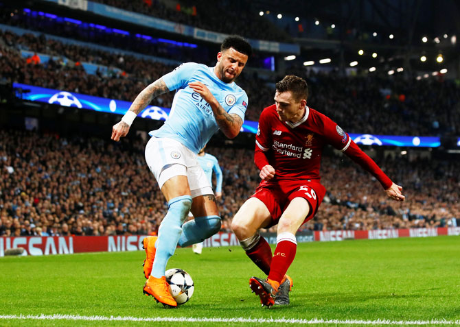 Manchester City's Kyle Walker in action with Liverpool's Andrew Robertson