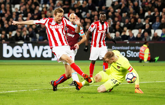Stoke City's Peter Crouch scores their first goal